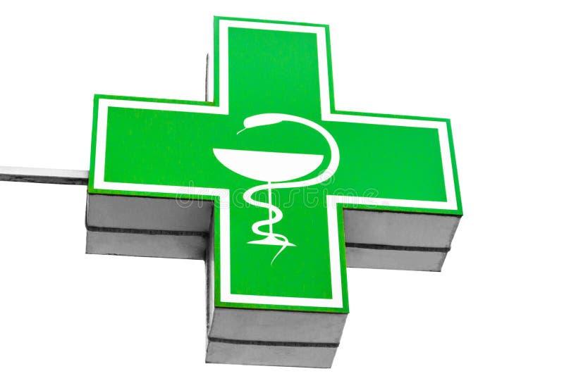 在白色背景隔绝的Iluminated绿色配药十字架 免版税库存照片