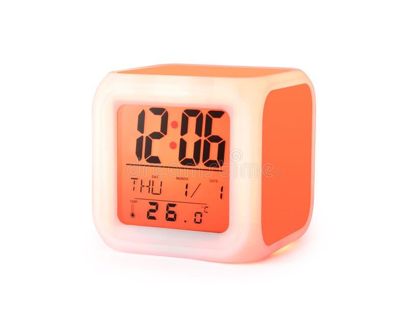 在白色背景隔绝的LED闹钟 现代样式数字显示 裁减路线反对橘黄色 图库摄影