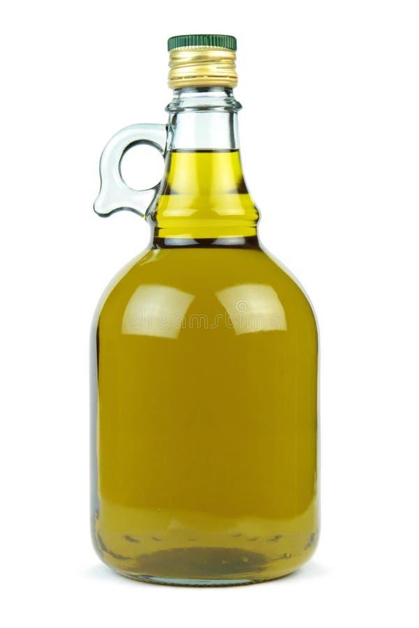 在白色背景隔绝的一个玻璃瓶的额外处女橄榄油 免版税库存照片