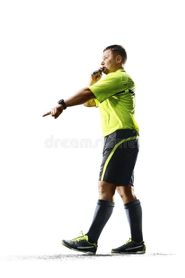 在白色背景隔绝的专业足球裁判员 免版税图库摄影