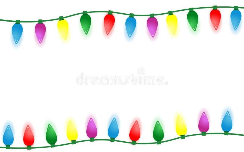 在白色背景隔绝的五颜六色的圣诞灯边界 图库摄影