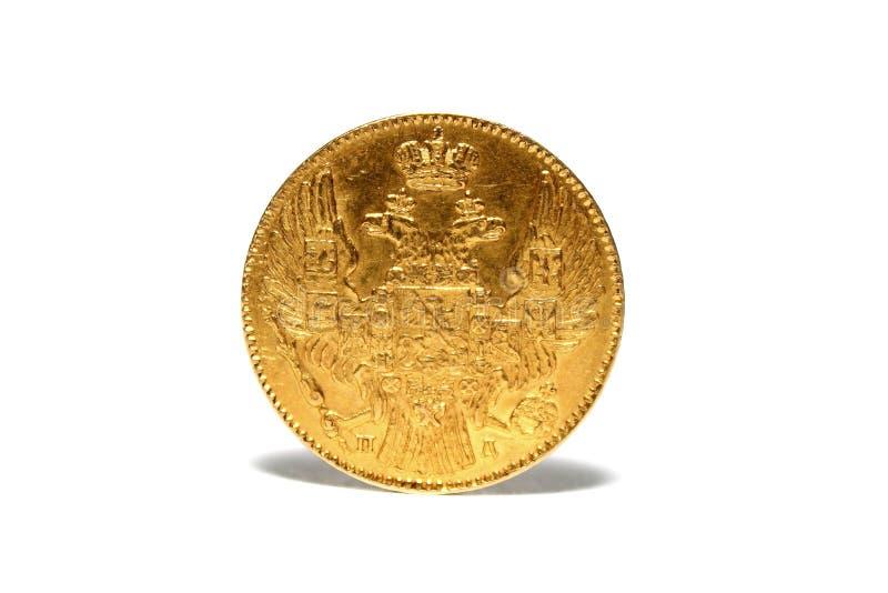 在白色背景隔绝的古金色硬币 免版税图库摄影