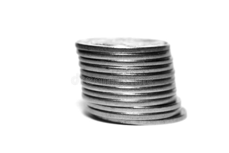 在白色背景隔绝的堆硬币,黑白照片 库存图片