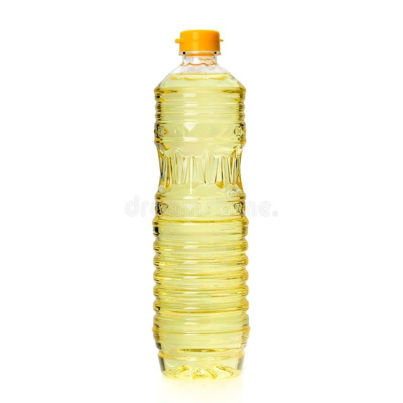 在白色背景隔绝的塑料瓶的菜油 库存照片