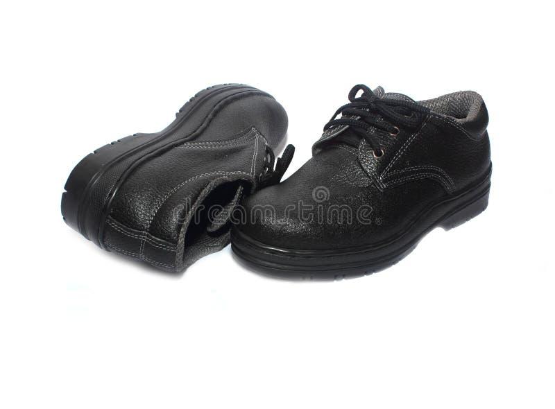在白色背景隔绝的安全靴 免版税库存照片