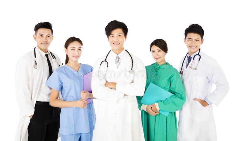在白色背景隔绝的微笑的医疗队 图库摄影