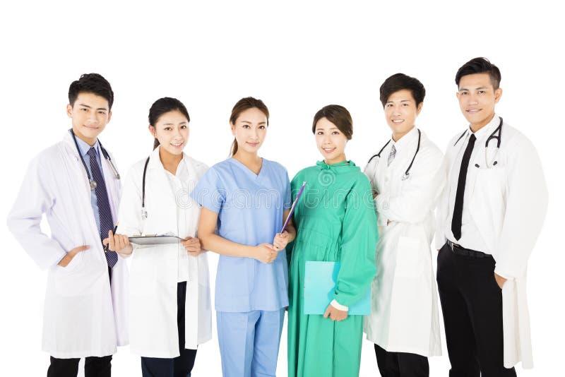 在白色背景隔绝的微笑的医疗队 库存图片