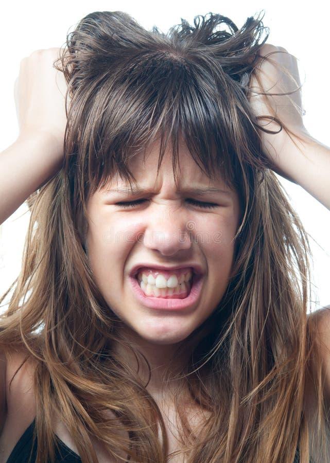 在白色背景隔绝的恼怒十几岁的女孩尖叫 库存照片