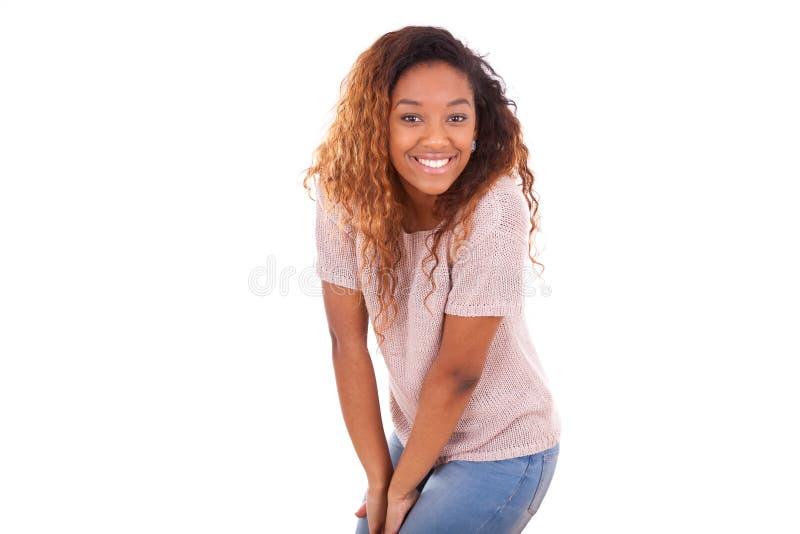 在白色背景隔绝的愉快的年轻非裔美国人- Blac 库存图片