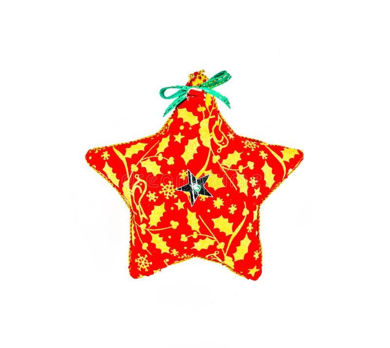 在白色背景隔绝的星状圣诞节装饰品 库存图片