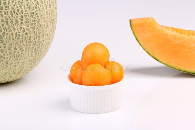 在白色背景隔绝的有机甜瓜瓜 库存图片