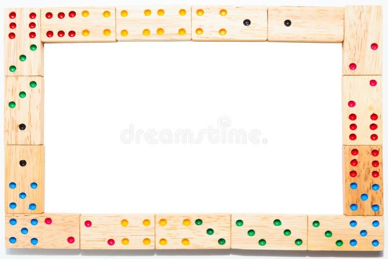 在白色背景隔绝的木多米诺框架,裁减路线 免版税库存照片