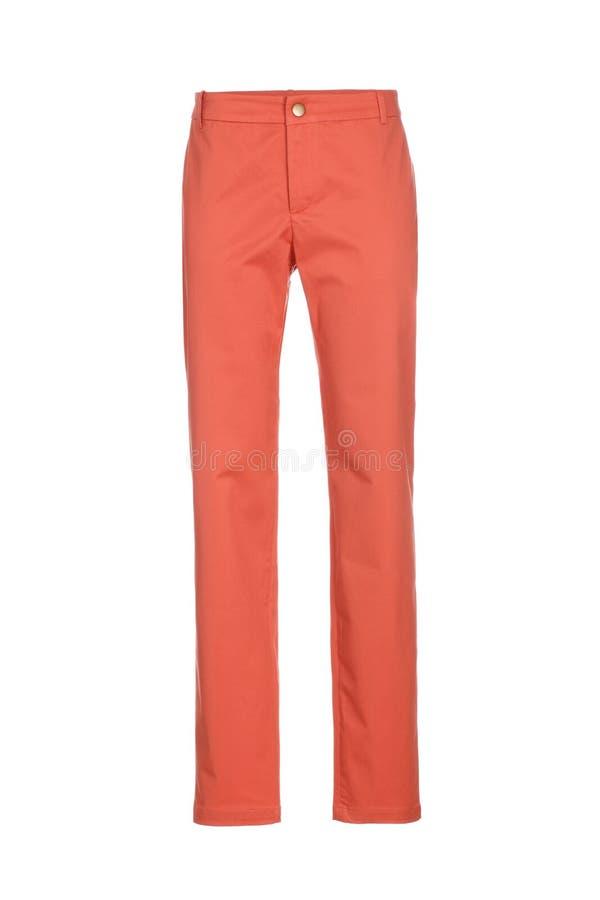 在白色背景隔绝的橙色妇女` s经典裤子 库存图片