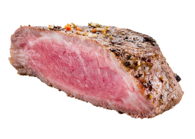 在白色背景隔绝的烤牛肉牛排 图库摄影