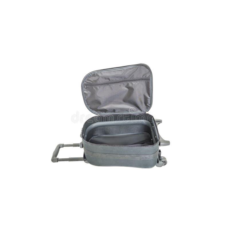 在白色背景隔绝的特写镜头开放黑行李,有塑料路辗的织品行李与裁减路线的旅行的 免版税库存照片