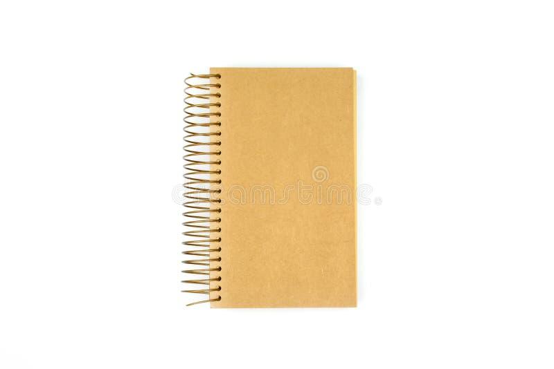 在白色背景隔绝的空白的棕色笔记本 库存图片