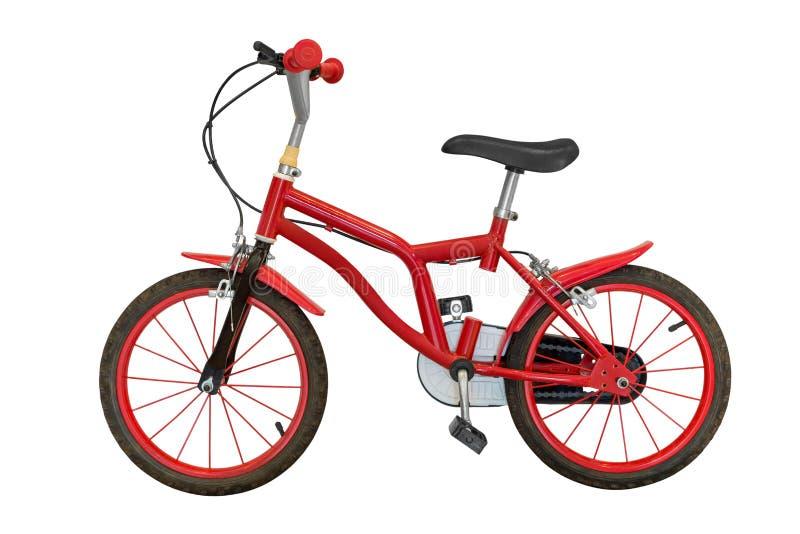 在白色背景隔绝的红色儿童的自行车 免版税库存照片