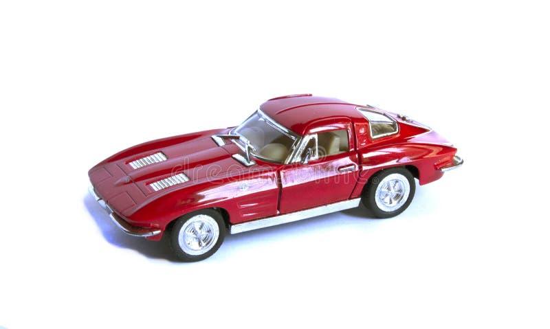 在白色背景隔绝的红色玩具汽车 免版税库存图片
