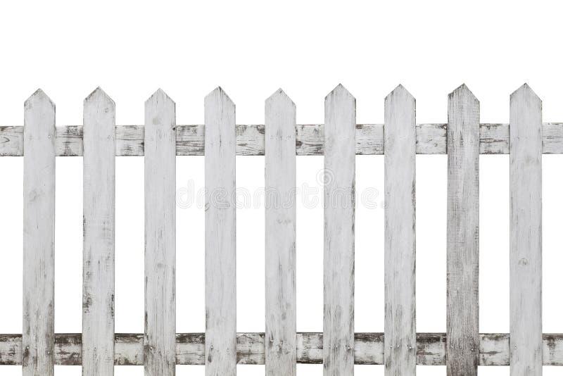 在白色背景隔绝的老白色木篱芭 库存照片