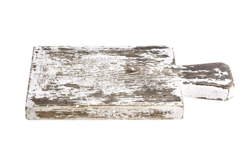 在白色背景隔绝的老砧板 库存照片