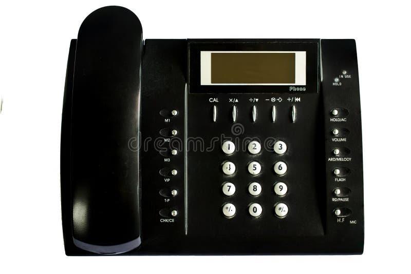 在白色背景隔绝的老黑办公室电话 免版税图库摄影