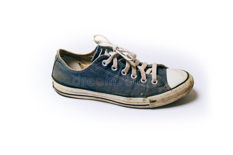 在白色背景隔绝的老&肮脏的鞋子 库存图片