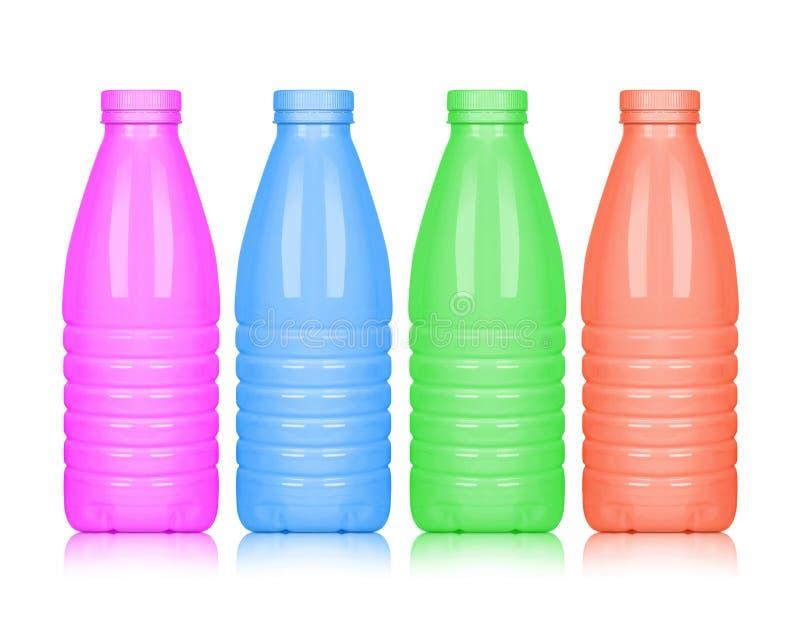在白色背景隔绝的色的塑料瓶 免版税库存照片