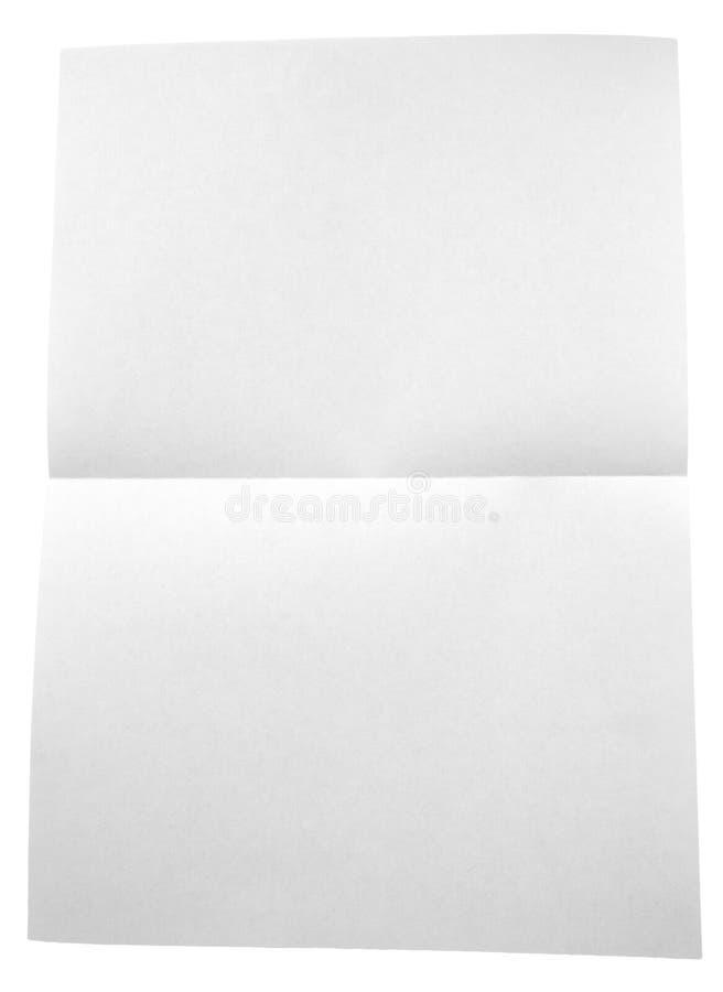 在白色背景隔绝的被折叠的白皮书 免版税库存照片