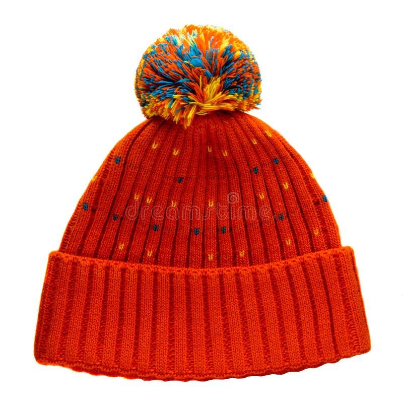 在白色背景隔绝的被编织的帽子 有绒球的帽子 ora 免版税库存照片