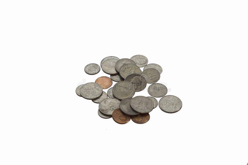 在白色背景隔绝的金钱硬币 免版税库存照片