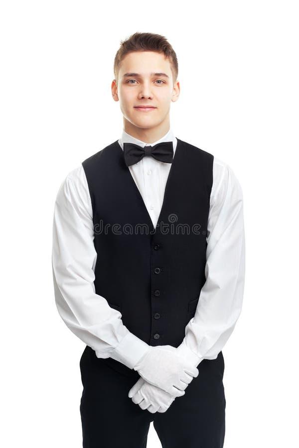 在白色背景隔绝的年轻微笑的侍者 免版税图库摄影