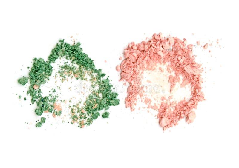 在白色背景隔绝的绿色和米黄眼影膏 免版税图库摄影