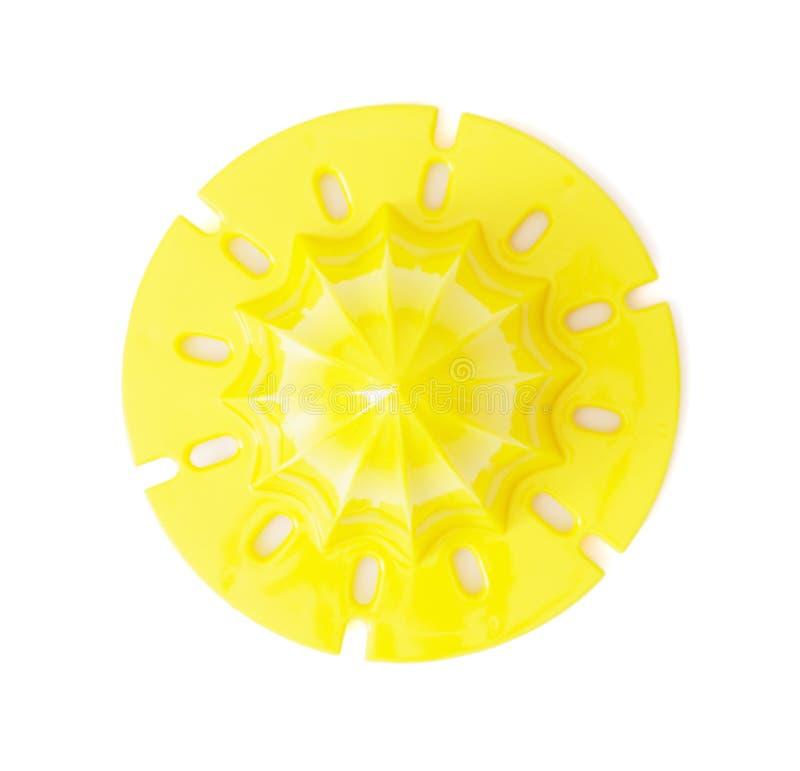 在白色背景隔绝的黄色柑橘榨汁器 免版税库存图片