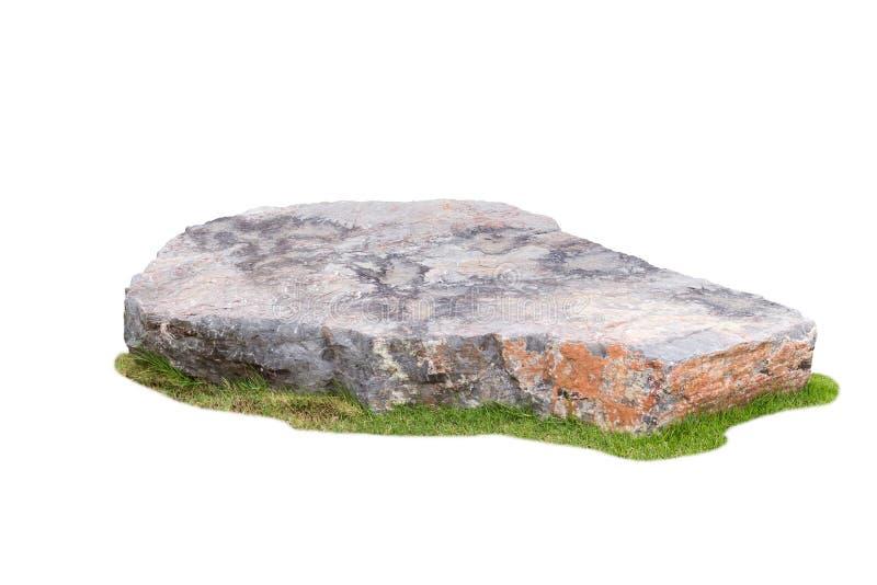在白色背景隔绝的绿草的石头 图库摄影