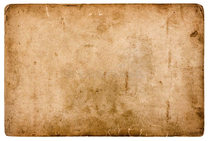 在白色背景隔绝的年迈的被弄脏的纸板料 免版税库存照片