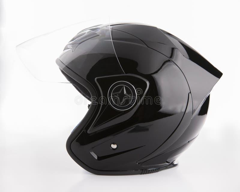 在白色背景隔绝的黑,发光的摩托车盔甲 免版税库存照片