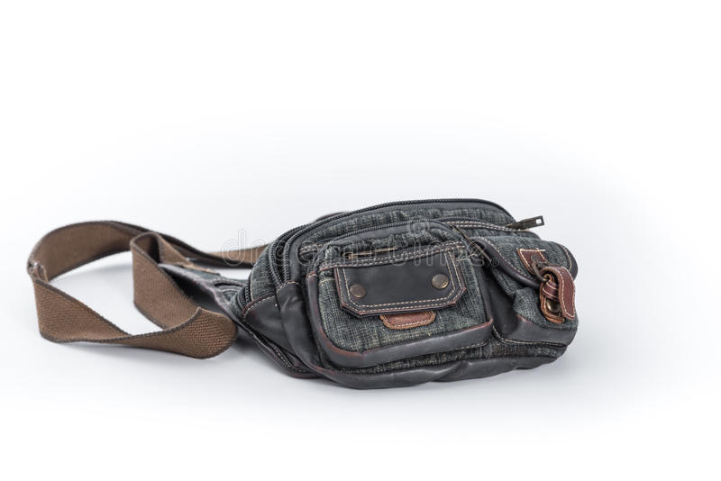 在白色背景,牛仔布传送带袋子的腰部囊 库存照片