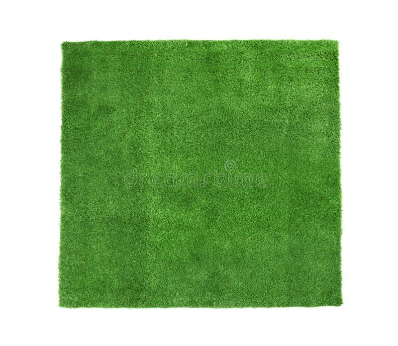 在白色背景,顶视图的人为草地毯 库存图片