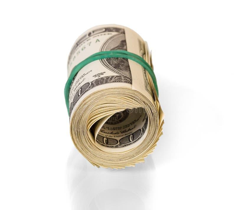 在白色背景滚动的美元 图库摄影