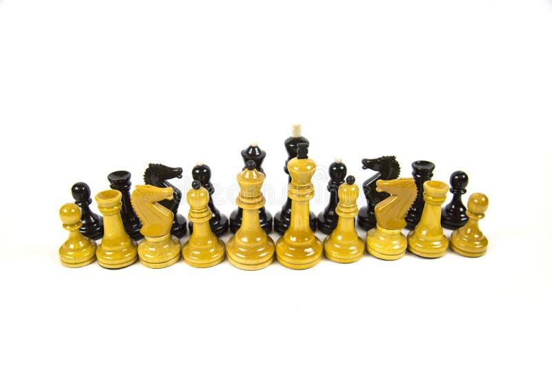 在白色背景-隔绝的两行的白色和黑棋子 免版税库存图片