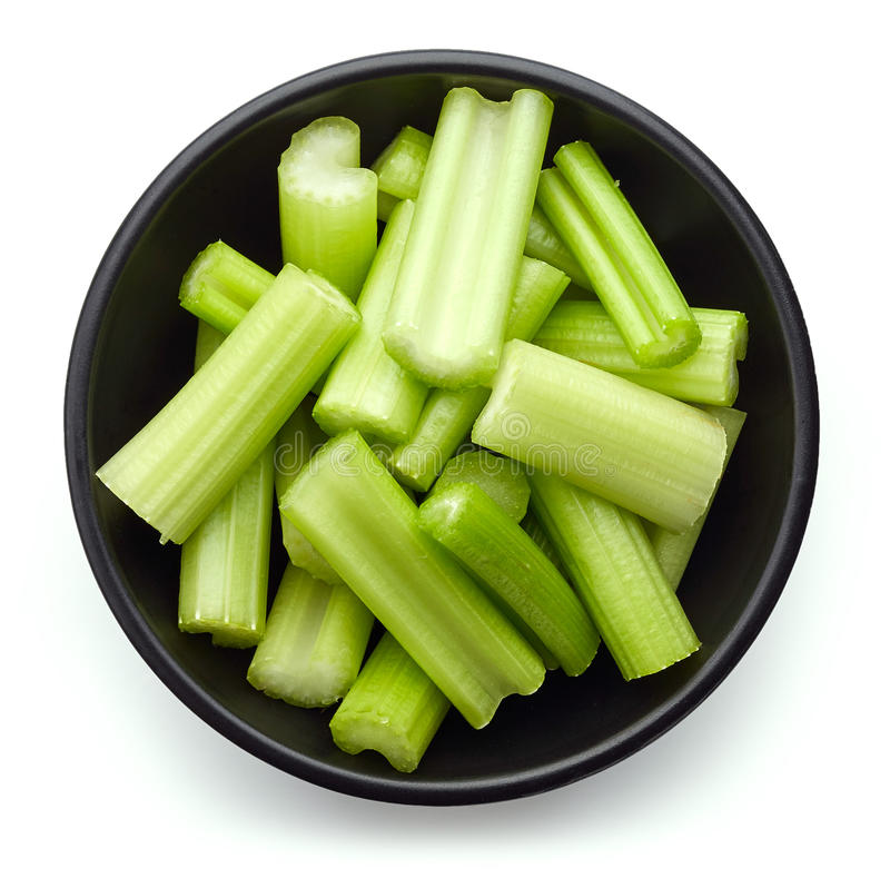 在白色芹菜隔绝的碗,从上面 免版税库存照片