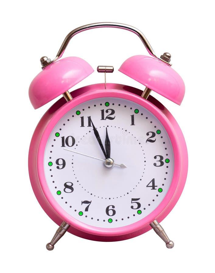 在白色被隔绝的背景的桃红色时钟,显示近似12个小时 日历看板卡以后的新的编号担任主角年 免版税图库摄影