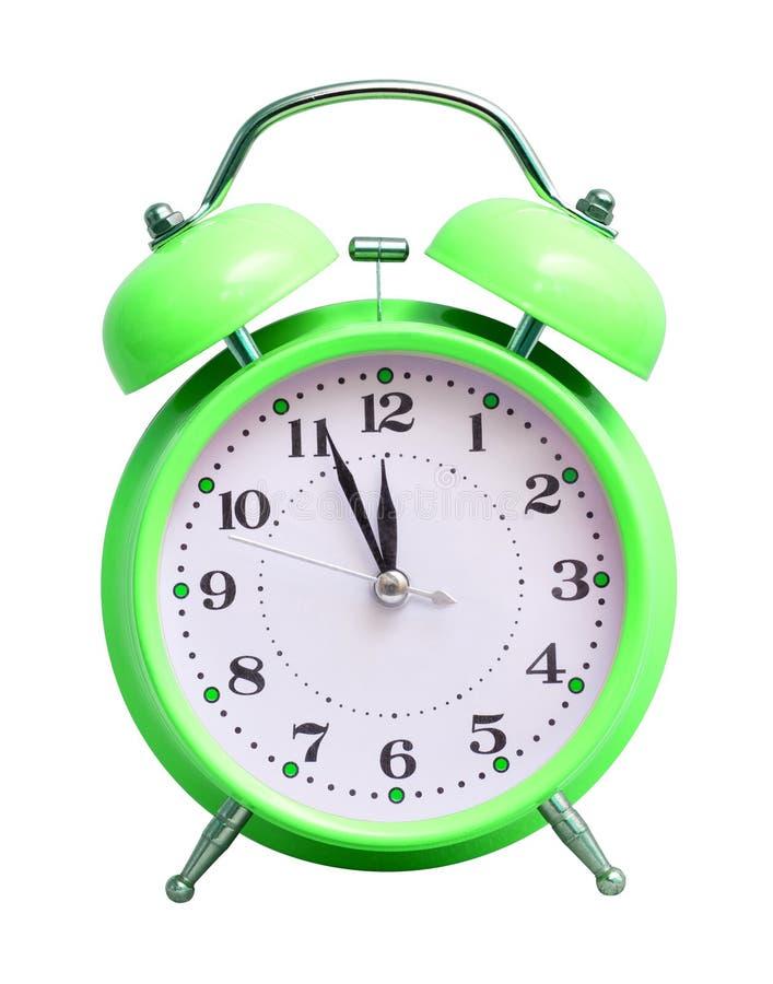 在白色被隔绝的背景的绿色时钟,显示近似12个小时 日历看板卡以后的新的编号担任主角年 免版税库存图片