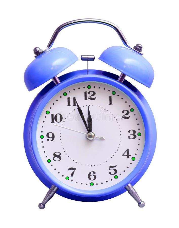 在白色被隔绝的背景的蓝色时钟,显示近似12个小时 日历看板卡以后的新的编号担任主角年 免版税库存照片