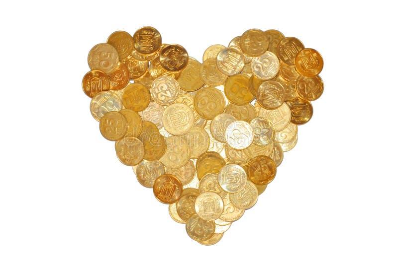 在白色象心脏标志的许多硬币隔绝的 免版税库存照片