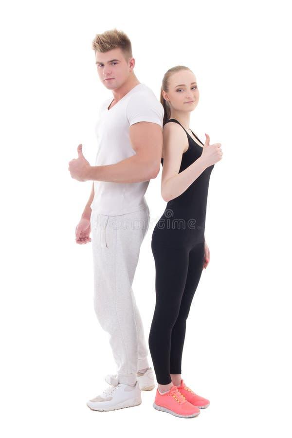 年轻在白色运动服赞许的隔绝的人和妇女 免版税图库摄影