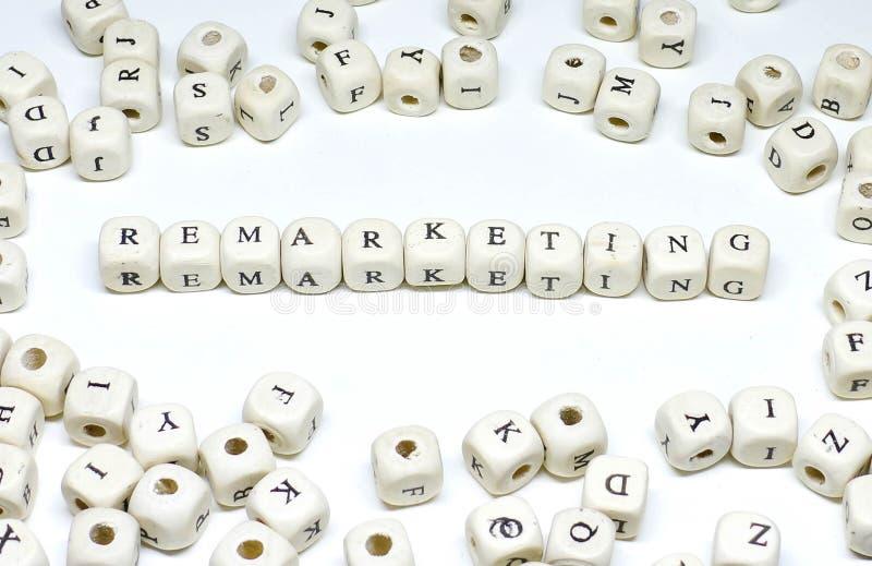 在白色重新出售背景木的abc的网上市场术语 免版税库存图片