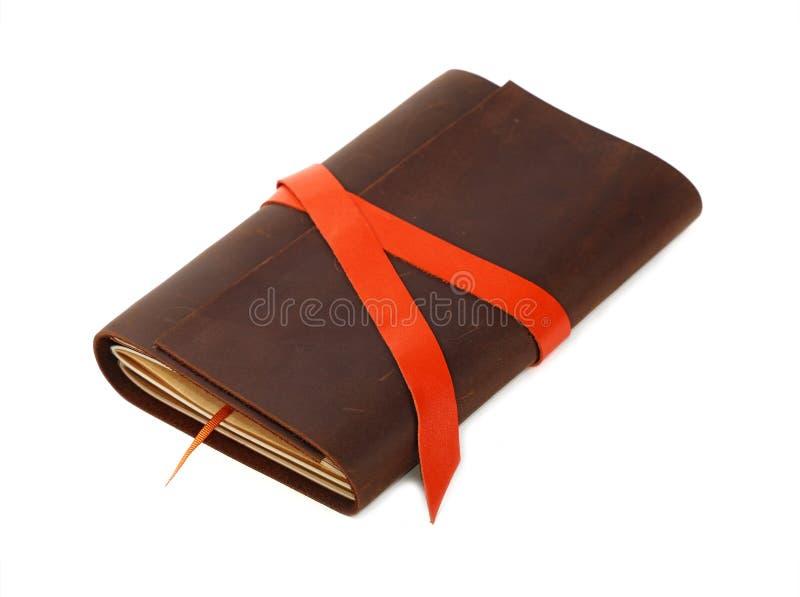 在白色隔绝的一个皮革盖子笔记本 库存照片