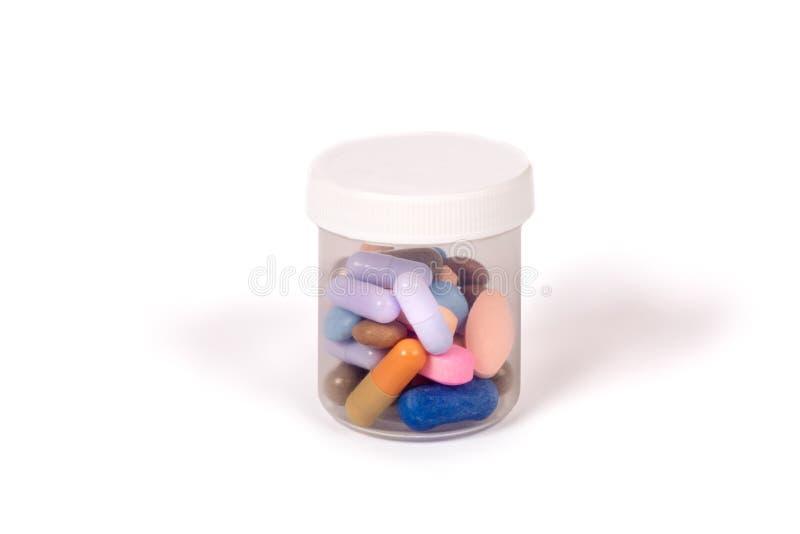 在白色隔绝的一个透亮箱子的药片 免版税库存照片
