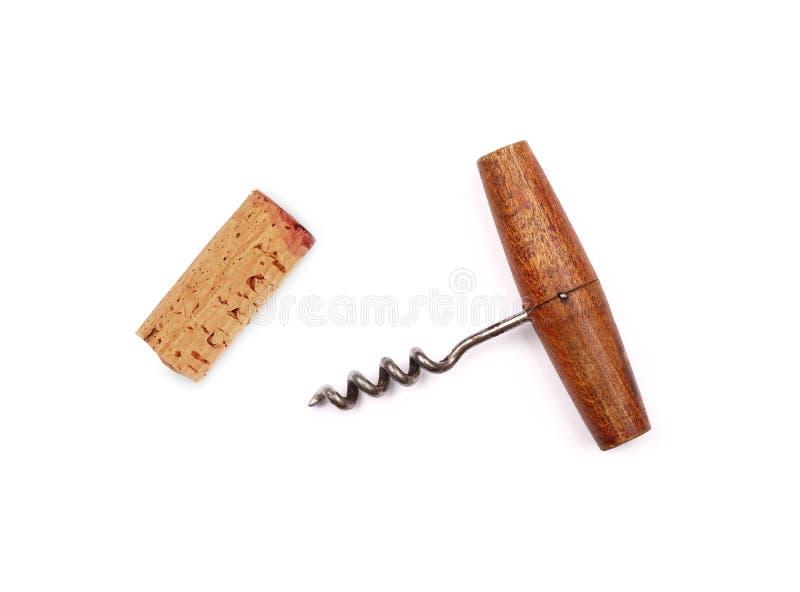 在白色隔绝的一老葡萄酒木拔塞螺旋瓶盖启子和红酒黄柏 免版税库存照片